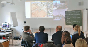 people in a room looking at a presentation